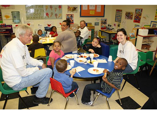 Volunteers from Rosemore make fall decorations with Dayspring Village families